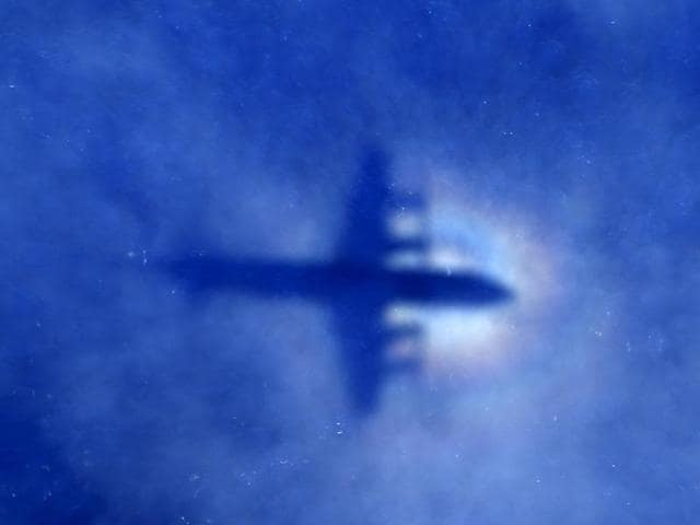 The shadow of a Royal New Zealand Air Force (RNZAF) P3 Orion maritime search aircraft can be seen on low-level clouds as it flies over the southern Indian Ocean looking for missing Malaysian Airlines flight MH370 in this March 31, 2014 file photo.