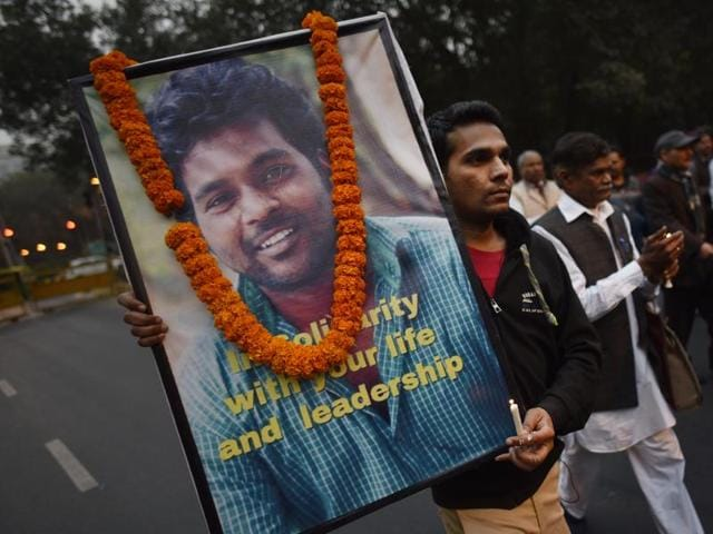 Samta Sainik members take part in a candle march while protesting over the death of Rohith Vemula at Jantar Mantar in New Delhi.