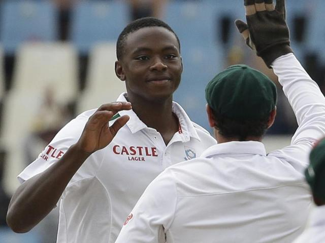 South Africa's bowler Kagiso Rabada celebrates with teammates after dismissing Jonathan Bairstow.