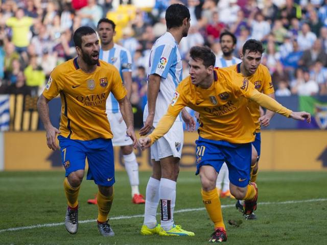 FC Barcelona's Lionel Messi, right, reacts next to teammate Arda Turan after scoring against Malaga during their La Liga match at La Rosaleda stadium in Malaga on January 23, 2016.