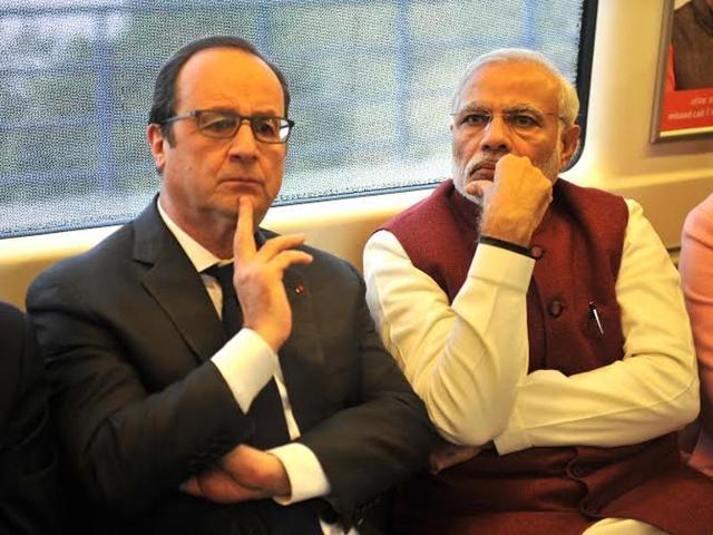Prime Minister Narendra Modi and French President Francois Hollande travel by Delhi Metro.