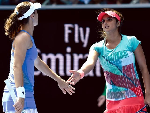 Martina Hingis and Sania Mirza react after winning a point during their third round match.