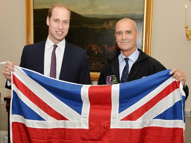 In this file photo, Henry Worsley is seen with Britain's Prince William as they hold the British flag in London.