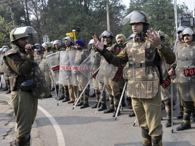Senior superintendent of police Manish Chaudhary giving directions to cops outside Rock Garden on Sunday.