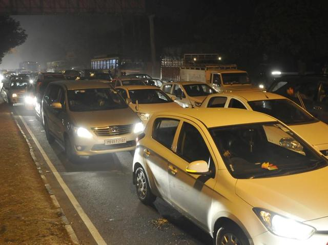 Vehicles stuck in a traffic jam after the cavalcades of Prime Minister Narendra Modi and French President Francois Hollande passed through Tribune Chowk in Chandigarh on Sunday.