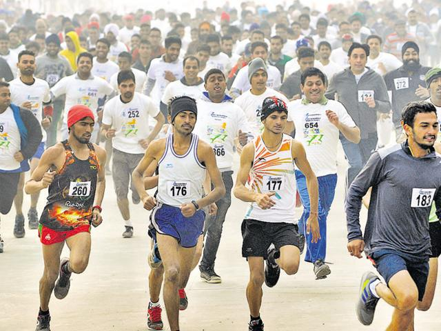 Participants during a mini-marathon at the Sector-78 stadium in SAS Nagar on Sunday.