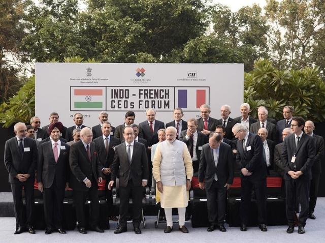 Francois Hollande and Narendra Modi with business leaders before a meeting of Indo-French CEOs Forum in Chandigarh on Sunday.