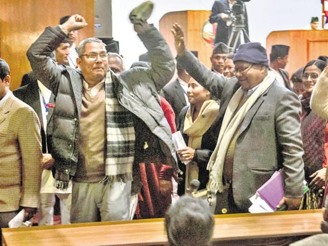 Nepalese lawmakers stage a protest as other lawmakers vote a constitution amendment bill in Kathmandu on Saturday.