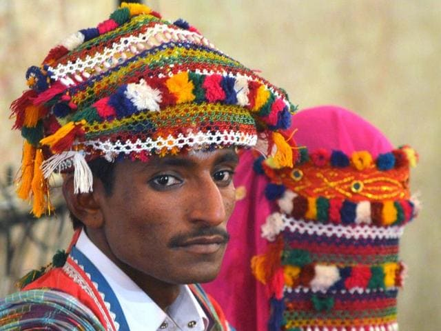 Pakistani Hindu groom and bride attend a mass wedding ceremony in Karachi on January 24, 2016.