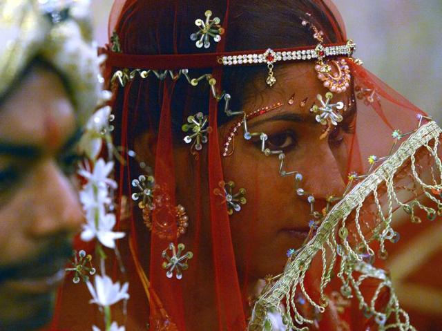 A Pakistani Hindu bride (R) and a groom attend a mass wedding ceremony in Karachi.