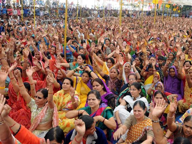 Supporters cheer as Sadhvi Ritambhara addresses them through mobile phone from New Delhi on Sunday.