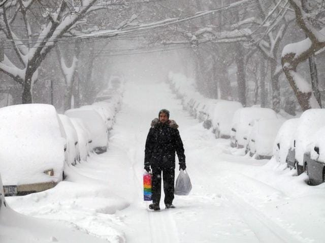 A man makes his way during a storm in New York on Saturday.