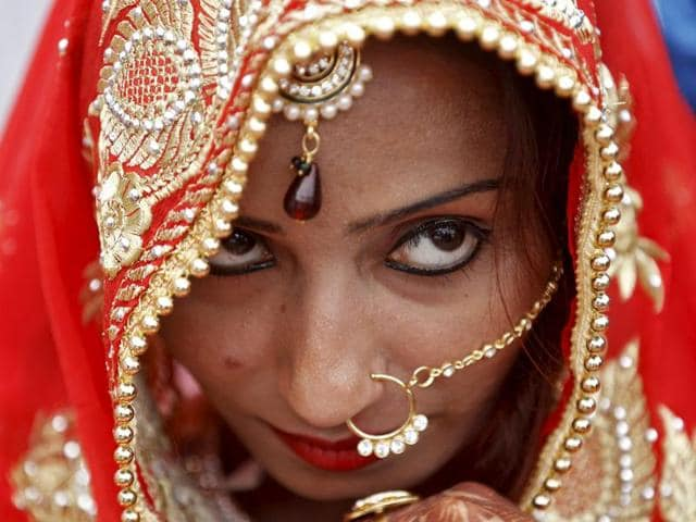 A Muslim bride watches during a mass wedding ceremony in Ahmedabad, India, January 22, 2016.