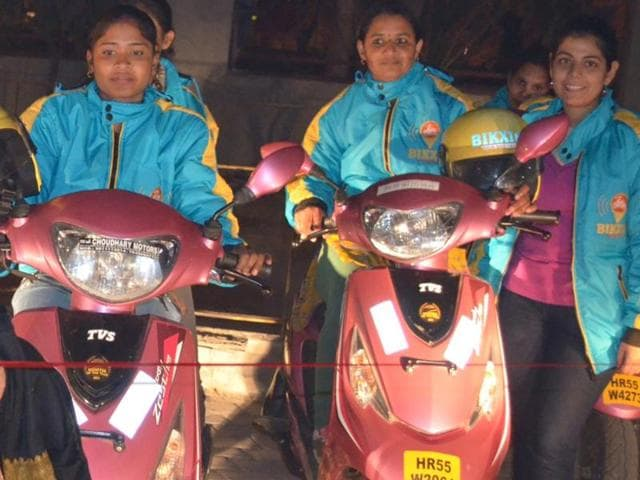 Commuters using the Bikxie Pink , a women-only two-wheeler taxi service which is the first-of-its-kind service in India that offers a fleet of Scooties driven only by women drivers.