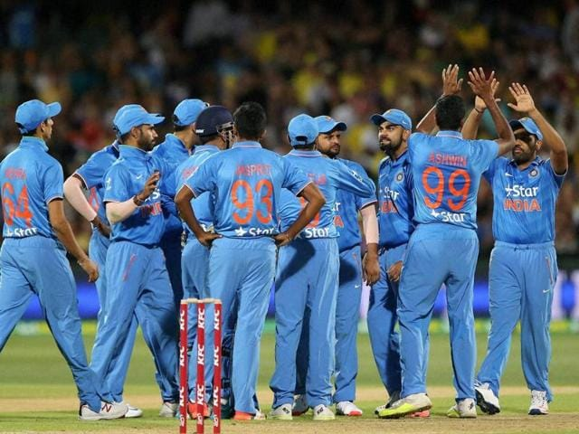 India celebrate the wicket of Australia's Aaron Finch during their T20 International cricket match in Adelaide.