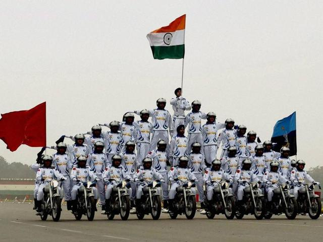 Army daredevils display their skills on motorcycles during the Republic Day parade at Janpath on Tuesday.