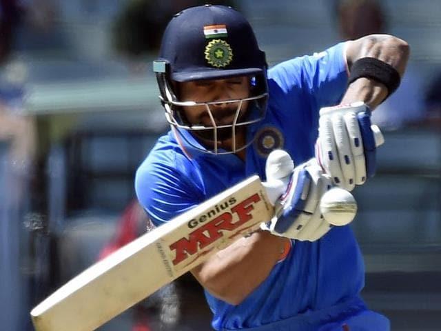 India's Yuvraj Singh celebrates catching out Australia's Chris Lynn with his teammates.