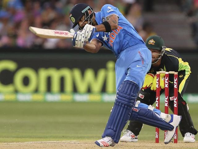 India's Virat Kohli plays a shot during their T20 International cricket match against Australia in Adelaide on January 26, 2016.