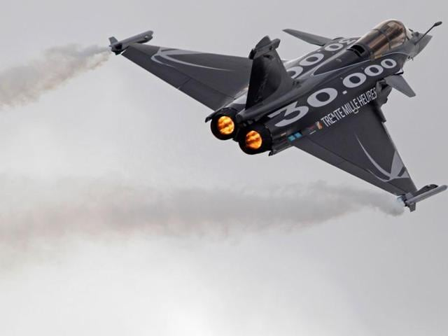 India inked an inter-governmental pact with France to buy 36 Rafale fighter planes on Monday but the two sides could take several weeks to hammer out the multi-billion euro deal.