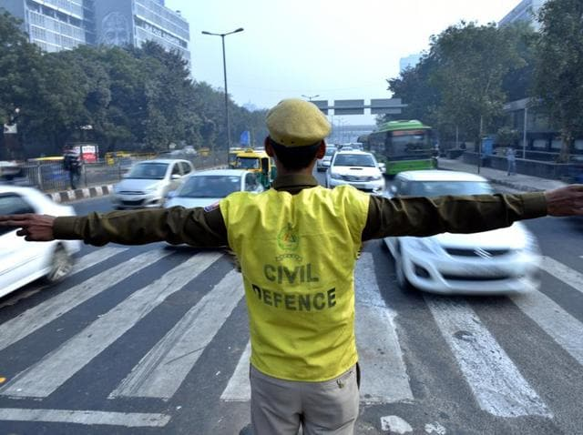 Civil defence personnel stand at Vijay Chowk to promote odd- even formula on cars in New Delhi.