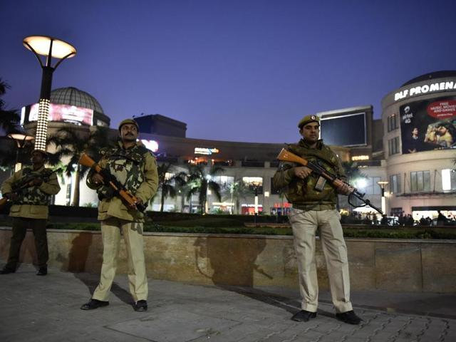 Commandos stand guard at the Vasant Kunj DLF Mall.