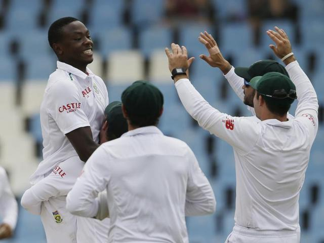 South Africa's bowler Kagiso Rabada celebrates with his teammates after dismissing Jonathan Bairstow.