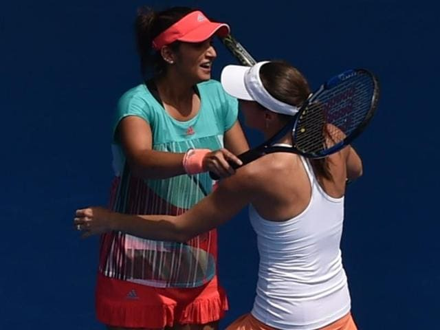 Martina Hingis, right, of Switzerland and Sania Mirza of India talk during their fourth round match against Anna-Lena Groenefeld of Germany Coco Vandeweghe of the United States at the Australian Open in Melbourne on January 26, 2016.