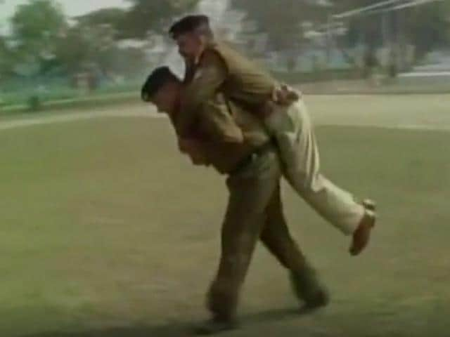 Screengrab of the video shows a police constable in Uttarakhand carrying a senior officer on his back.