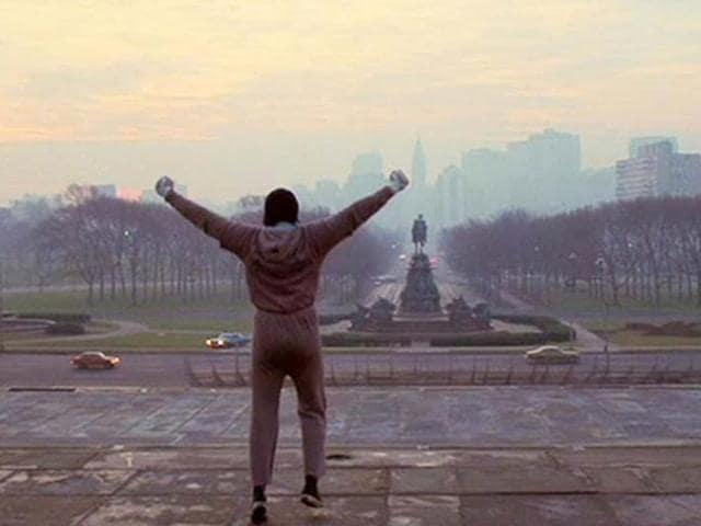 Sylvester Stallone at the iconic Philly steps in a still from Rocky.