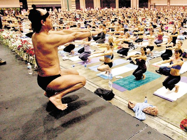 Bikram Choudhury, founder of the Yoga College of India, during one of his classes at the Los Angeles Convention Center.