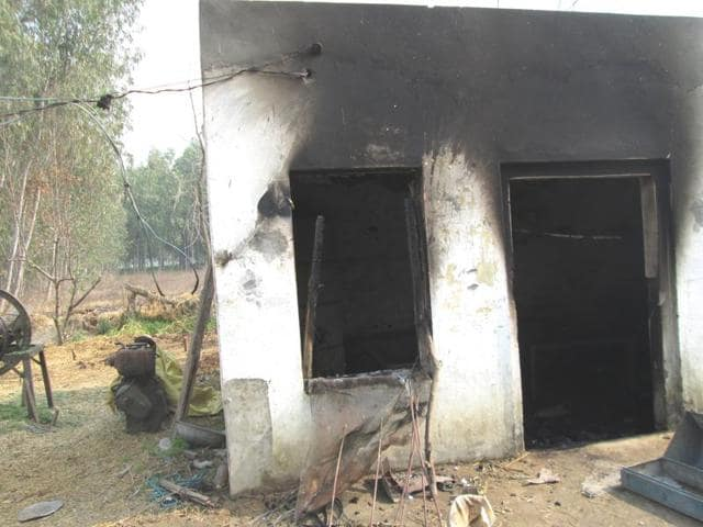 The house and vehicles burnt by the angry mob in Bassi Vajid village.