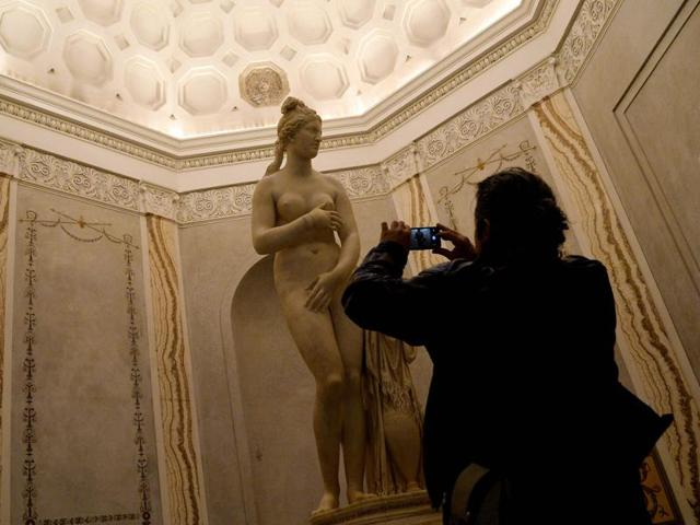 A visitor pictures the Venere Capitolina or Capitoline Venus on display at Rome's Capitoline Museum on January 26, 2016. The visiting Iranian president Hassan Rouhani has denied asking his Italian hosts to cover up the classical nude statues in the museum.
