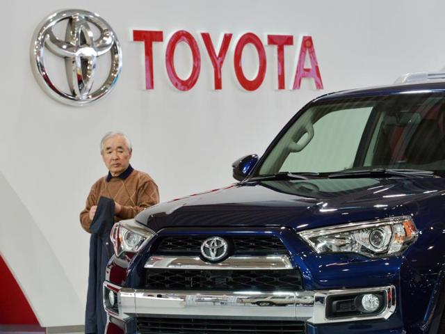 Customers check vehicles from Japanese auto giant Toyota Motor at the company's showroom in Tokyo.