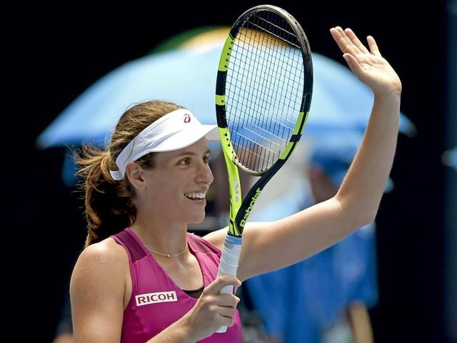 Britain's Johanna Konta (R) and China's Zhang Shuai embrace at the net after Konta won their quarter-final match at the Australian Open in Melbourne on January 27, 2016.