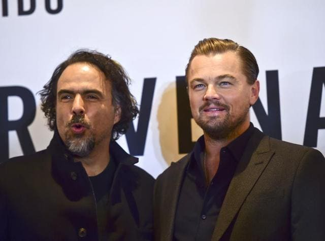 Mexican Director Alejandro Gonzalez Iñarritu (L) and US actor Leonardo Di Caprio (R) pose before a press conference in Mexico City.