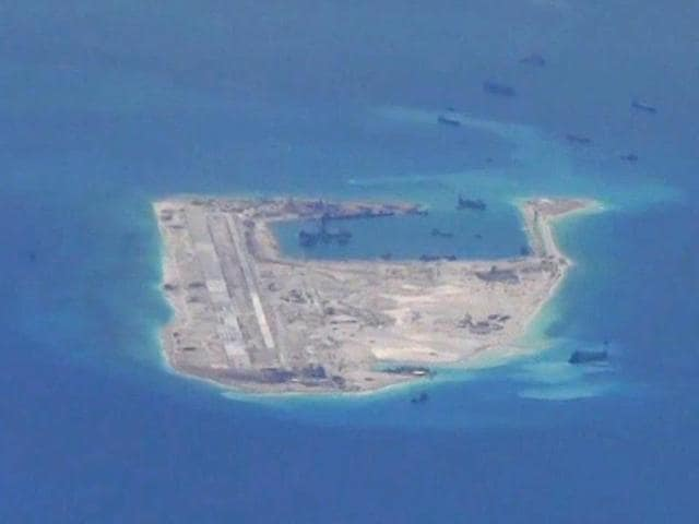 Chinese vessels are purportedly seen in the waters around Fiery Cross Reef in the disputed Spratly Islands in the South China Sea in this still image provided by the US Navy. China is planning to build a floating nuclear power station as it seeks to double its atomic capacity by 2020.