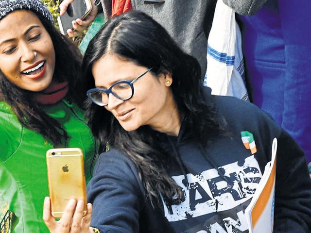 Visitors click selfies during the Republic Day parade at Rajpath on Tuesday.