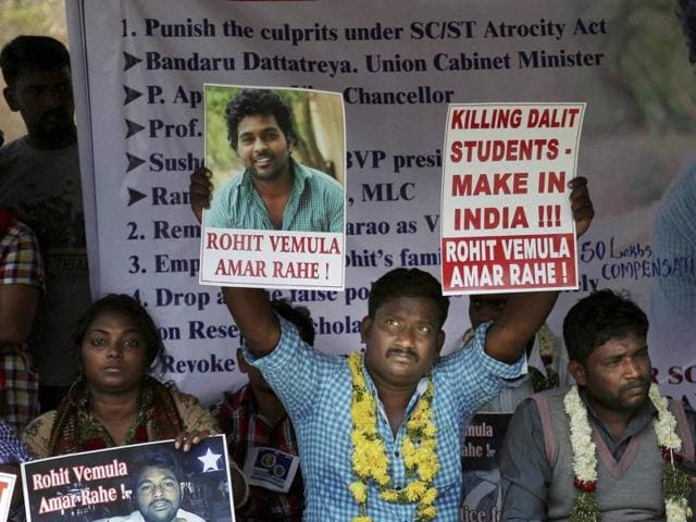A student holds a banner and a photograph of Rohith Vemula, as he sits with others during a hunger strike to demand justice in Hyderabad on Thursday.
