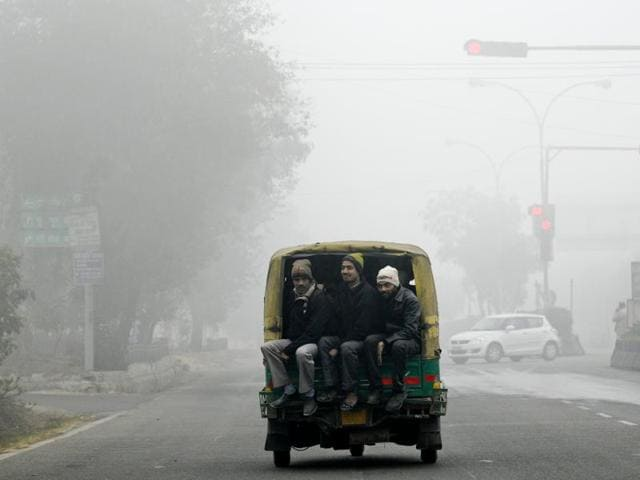 Heavy fog and cold wave engulfed Noida on Tuesday.