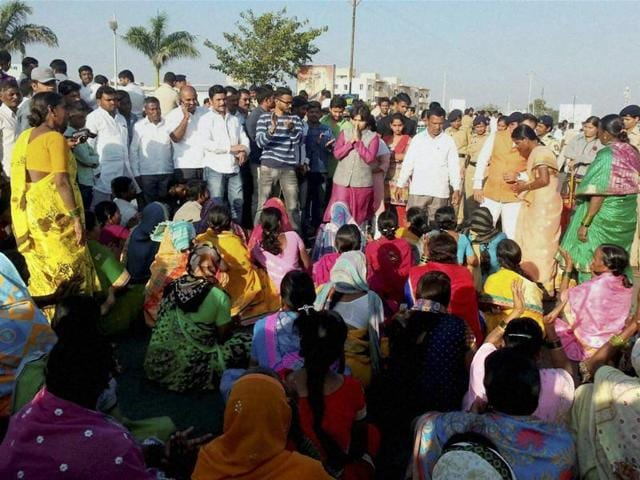 Trupti Desai (in pink) who headed the protest by women activists for entry to the Shani Shignapur temple complex participates in a dharna at the temple.