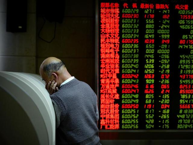 An investor uses a computer terminal to check stock prices at a securities company in Beijing.