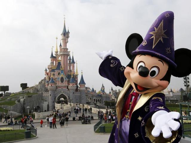 File photo of  Disney character Mickey posing in front of the Sleeping Beauty Castle at Disneyland theme park as part of the 20th birthday celebrations of the park, outside Paris.
