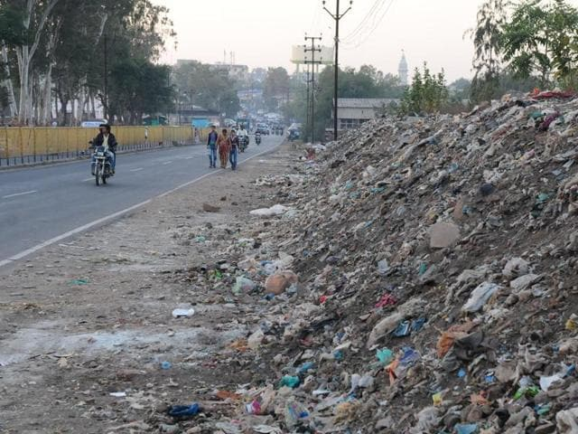 Heaps of garbage at the side of the Hoshangabad Road in Bhopal on Wednesday. The BMC is all set to launch an app which will let the public click photos of garbage and send it to the civic body.