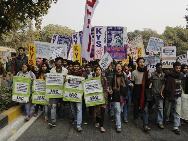Students march towards the office of India's education minister during a protest.