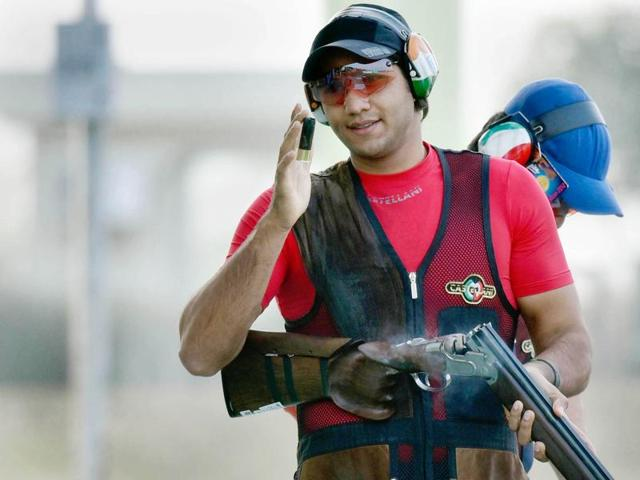 Indian shooter Kynan Chenai in action during trap shooting match in Asian Olympic Qualifying Competition at Dr Karni Singh Shooting Range in New Delhi.
