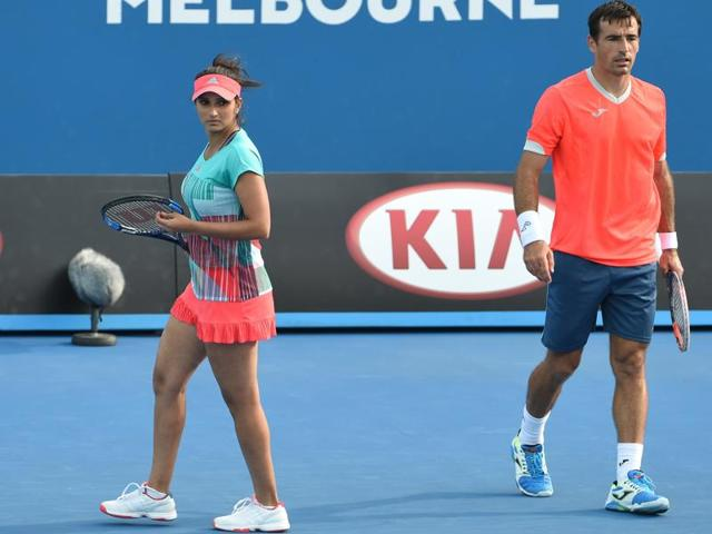 India's Sania Mirza (L) and partner Croatia's Ivan Dodig during their mixed doubles match against Kazakhstan's Yaroslava Shvedova and Pakistan's Aisam-Ul-Haq Qureshi on day nine of the 2016 Australian Open in Melbourne on January 26, 2016.