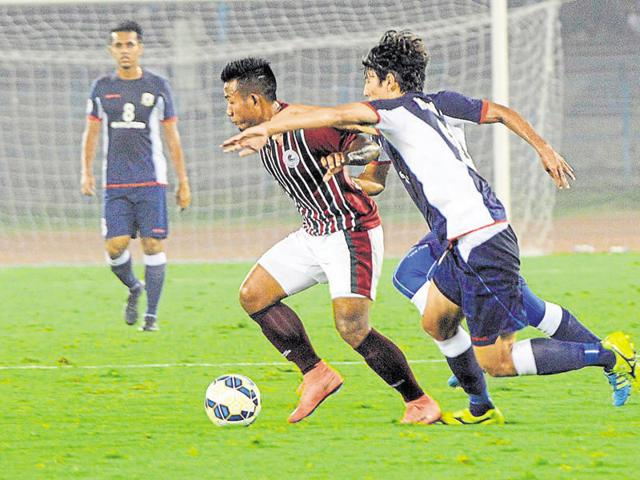 Mohun Bagan's Jeje Lalpekhlua (maroon) in action against Tampines Rovers in the Asian Champions League qualifiers in Kolkata on January 27.