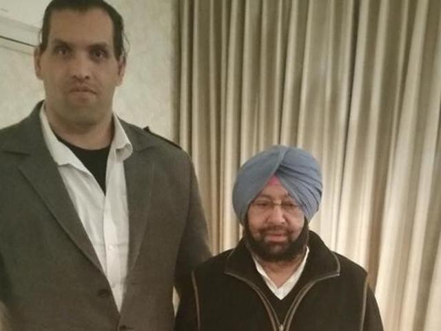 Punjab Congress president Captain Amarinder Singh with wrestler The Great Khali