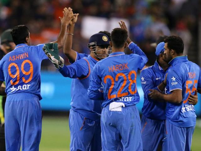 Indian teammates celebrate the wicket of Australia's Shaun Marsh during their T20 cricket match.