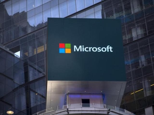 The Microsoft logo is seen on an electronic billboard on an office building in New York City.